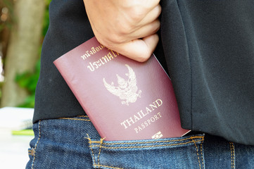 thailand passport in rear pocket jeans