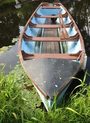 close up of rowing boat with oars