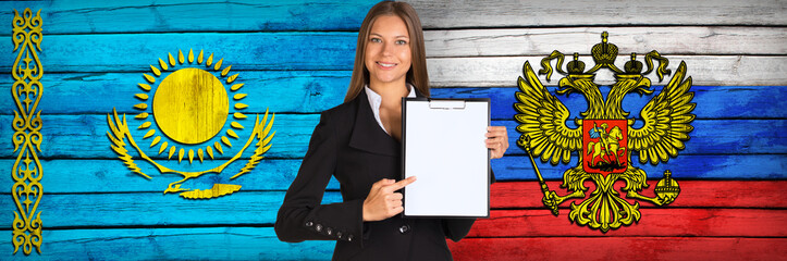 Businesswoman holding paper holder