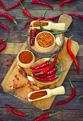 Red chilli peppers and spices on the table