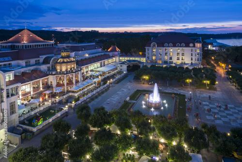 Aerial, night view of Sopot molo square in Poland