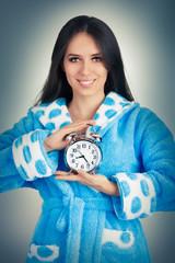 Young Woman in Bathrobe Holding an Alarm Clock