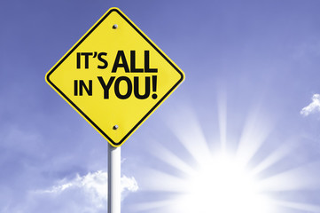 It's All In You road sign with sun background