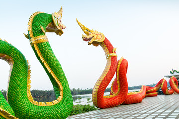 Red and green serpent statue at Wat Saman Rattana Ram Chachoengs