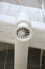 Industrial steel ventilation pipe inside of building.