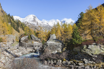 Footbridge over a river in the valley