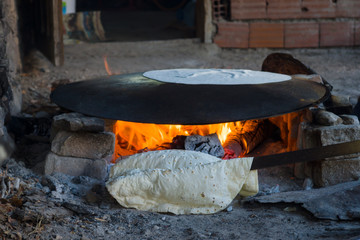 Traditional rustic flatbread cooked on an open fire. Turkey.