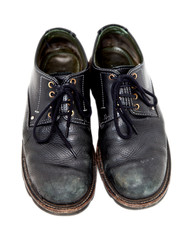 A pair of old black mens shoes.