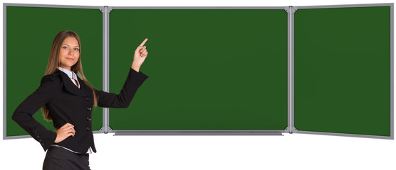 Businesswoman pointing her finger on chalkboard
