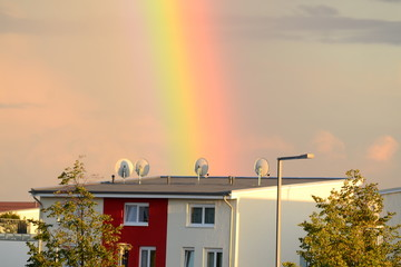 Rainbow over a residential two-story house