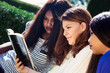 Three Girls Studying the Bible Together - 69008896