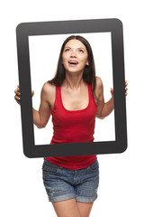 Excited teen girl looking through frame