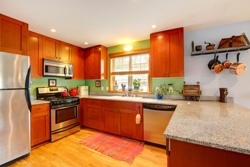 Kitchen with granite tops and green back splash