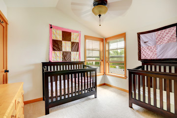 Nursery room with two cribs