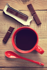 Coffee cup with chocolate in retro style