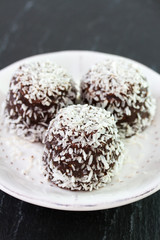 chocolate coconut sweets on white plate
