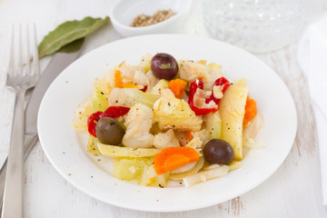 salad fish with vegetables on plate