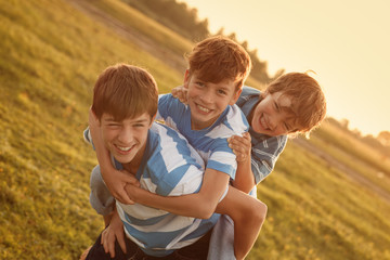 Portrait of three happy cheerful brothers