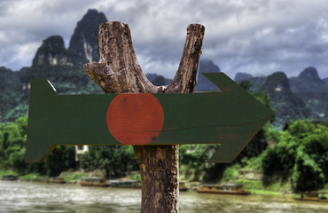 Bangladesh wooden sign with a forest background