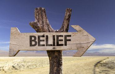 Belief wooden sign with a desert background