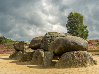 Dramatic sky over megalithic stones in Drenthe, Netherlands
