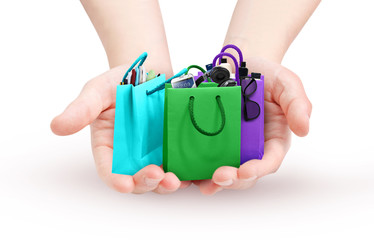 Hands holding colorful bags
