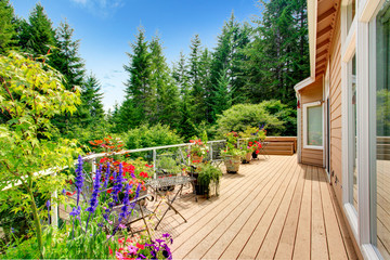 Wooden walkout deck with vibrant color flowers