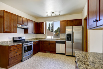 Kitchen cabinets with granite tops and ss-appliances