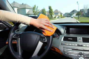 Hand cleaning car.