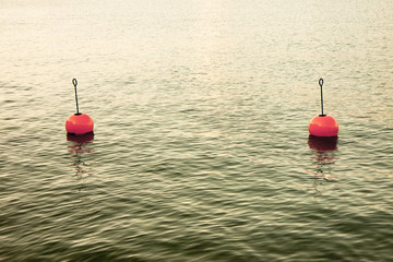 Red bouy on a calm lake