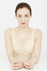 Portrait of young woman in lace camisole