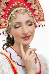 Coquettish young woman portrait in russian traditional costume