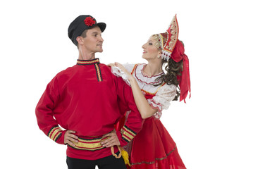 Conversation young couple in russian traditional costumes