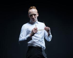 Fashion man model looks like nerd or hipster from horror, white