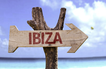 Ibiza sign with a beach on background