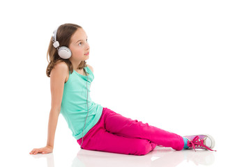 Pensive girl enjoying the music
