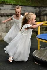 TwoBridesmaids playing on playground