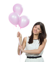 Happy woman with pink balloons as a present