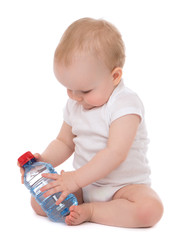 Infant child baby sitting with bottle of drinking water