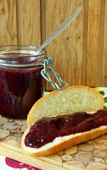 Bread with jam and a jar of jam.