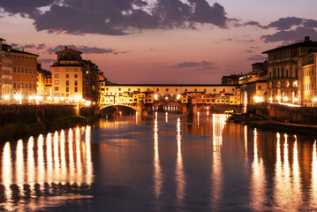 The scenic old bridge of Florence in a night photo