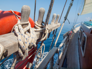 tied off rope on a  wooden sailing boat