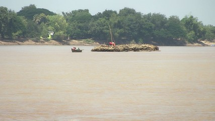 bamboo rafts on the mekong river towed by a small boat (5)