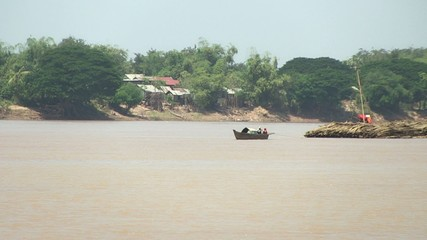 Bamboo rafts on the mekong river towed by a small boat (6)
