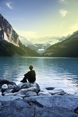 Woman sit in front of the beautiful scenery of the lake Louise