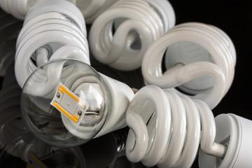 Led bulb between several CFL lamps