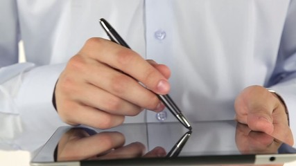 Hand to use a tablet and stylus