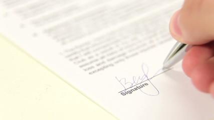 Closeup of signature and pen