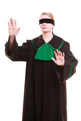 Lawyer attorney in classic polish gown covering eyes