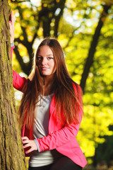 Fall season. Portrait girl young woman in autumnal park forest.